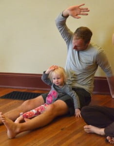 Dad and daughter in Family Yoga