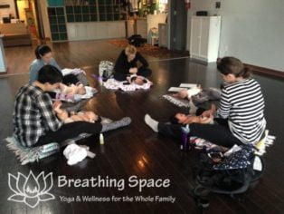 Parents and babies on mats during Infant Massage workshop