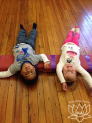 Little family yoga toddlers on a mat