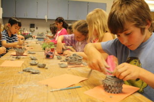 Kids working with clay
