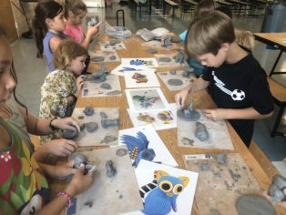 Kids working with clay at a school program