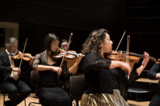 Orpheus Chamber Orchestra - Violin Section. Photo Credit: Neda Navaee