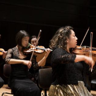 Orpheus Chamber Orchestra - Violin Section. Photo Credit: Neda Navaee