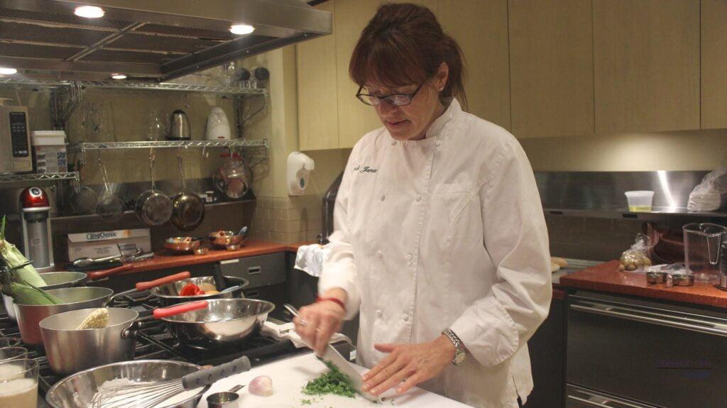 Chef Wendi James preps vegetables in Hill Center's kitchen