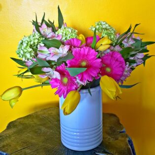 Flower arrangement with colorful flowers and greenery