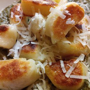 Cassava Dumplings on top of Callaloo puree